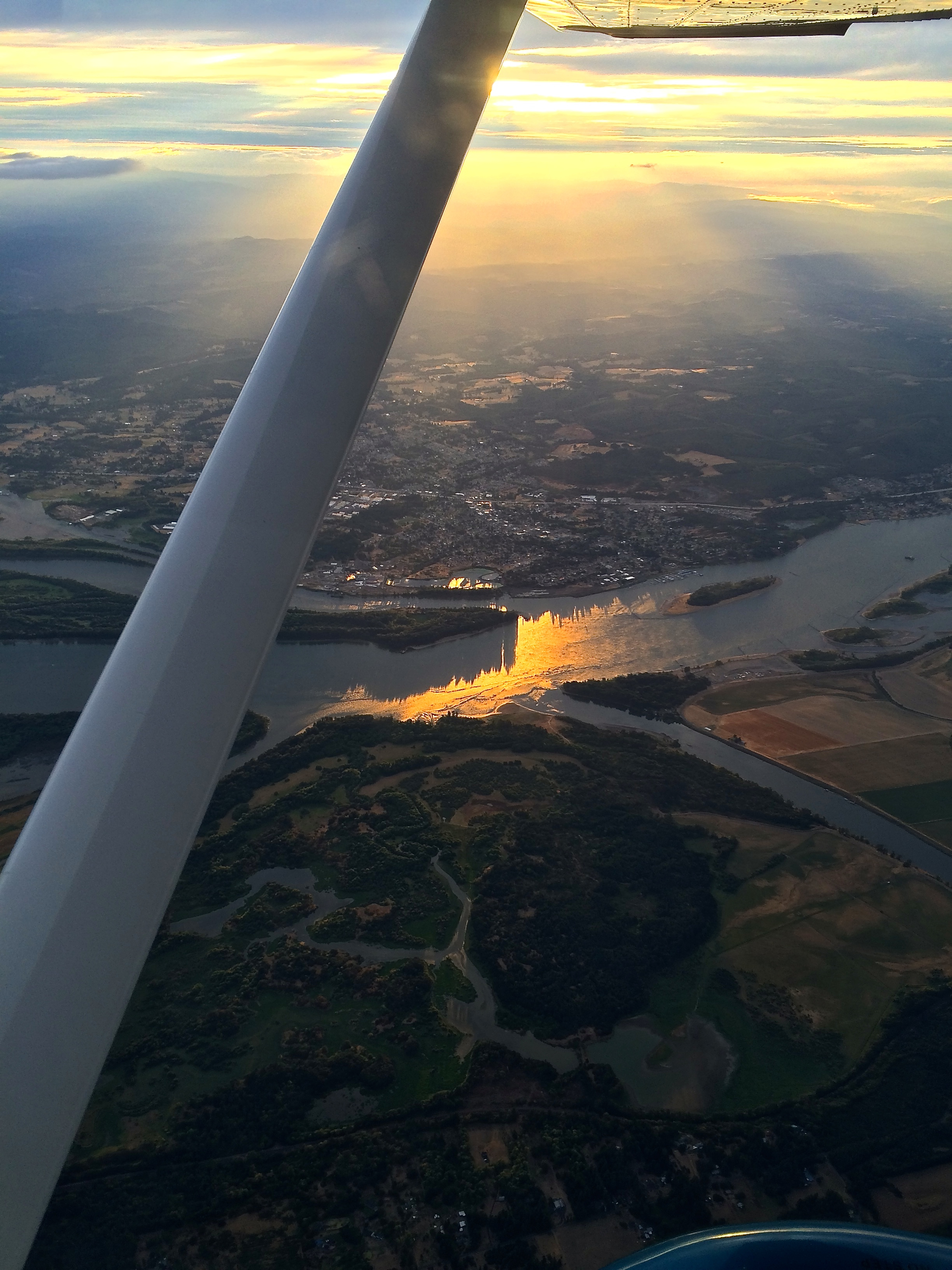 Photo of the town of St. Helens, Oregon and the Columbia River in the late afternoon sunlight.